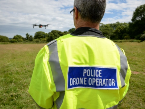 An officer from Devon & Cornwall Police flies a DJI Inspire 1s drone, as they launch the first fully operational drone unit used by police at Westpoint Arena in Clyst St Mary, near Exeter, in co-operation with Dorset Police.